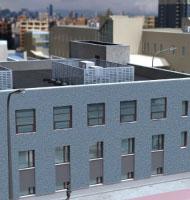 Système lesté d'habillage de machines pour toiture-terrasse
